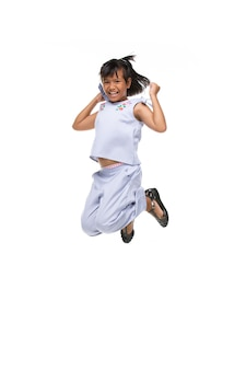 Portrait of black asian child jumping isolated on white .