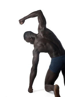 Portrait of a black athletic man on his back