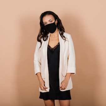 Portrait of black businesswoman wearing face mask during virus epidemic in a studio.