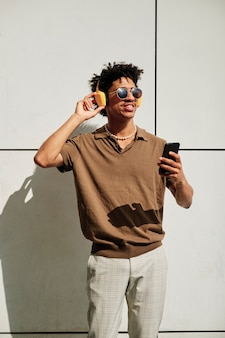 Portrait of a black man in the city - fashion concept