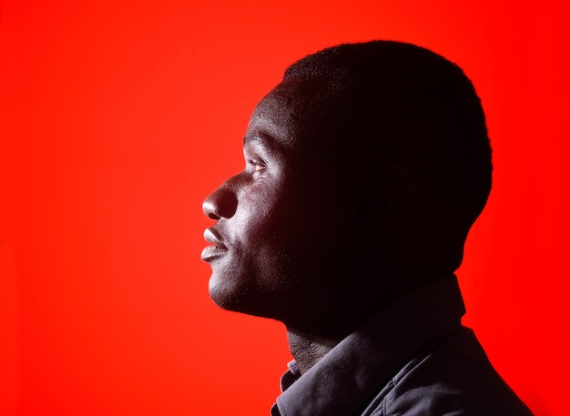 Portrait of a black man on red