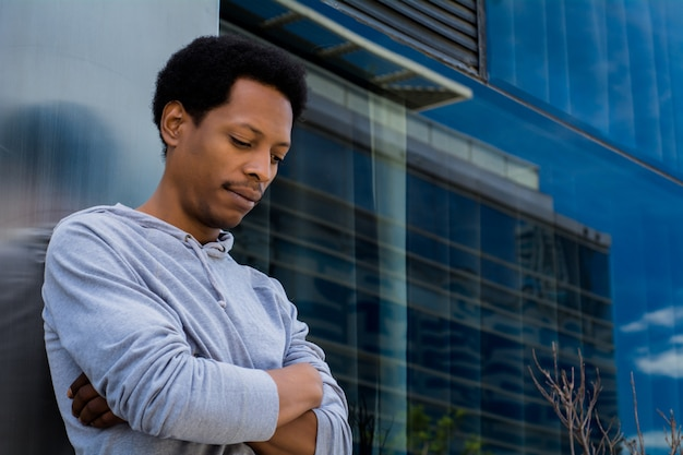 Portrait of black man in urban building.