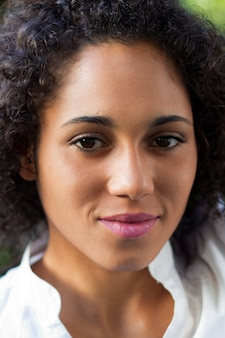 Portrait of black woman with curly hair
