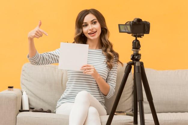 Portrait of blogger recording video