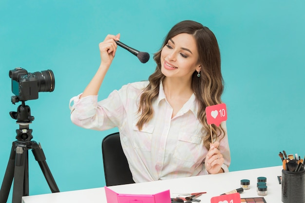 Portrait of blogger trying out make-up products