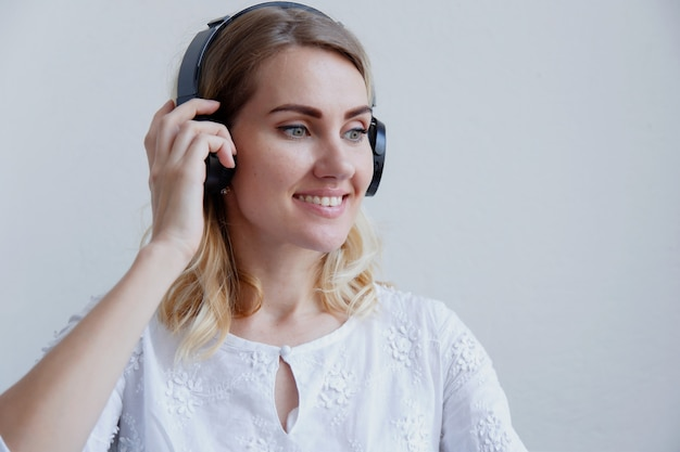 Portrait of a blond girl with headphones