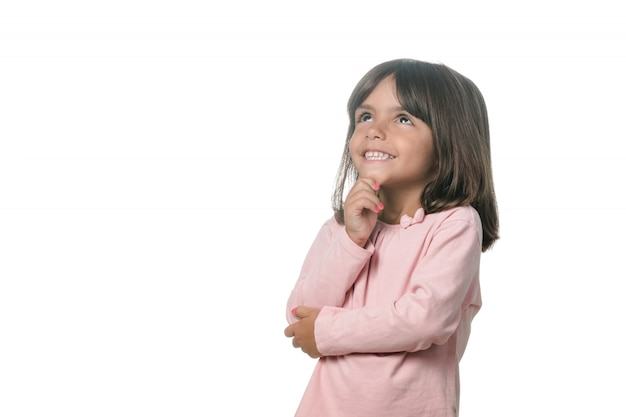 Portrait of a blonde little girl pensive on the white background