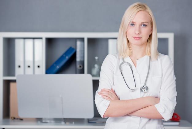 Portrait of a blonde woman doctor