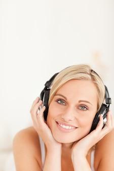 Portrait of a blonde woman wearing headphones