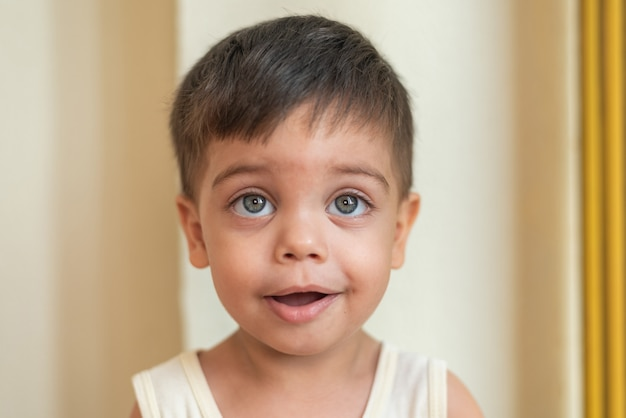 Portrait of blue-eyed baby looking with calm expression