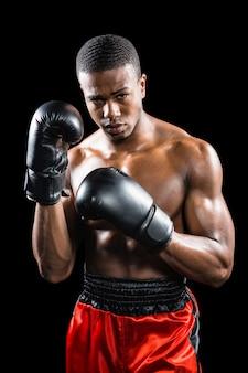 Portrait of boxer performing uppercut
