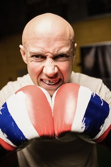 Portrait of boxer practicing boxing