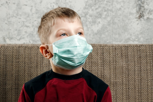 Portrait of a boy, a child in a medical mask