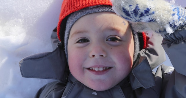 Portrait of a boy close up in winter