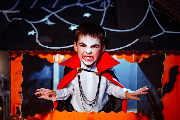 Portrait of a boy dressed in a costume of a vampire