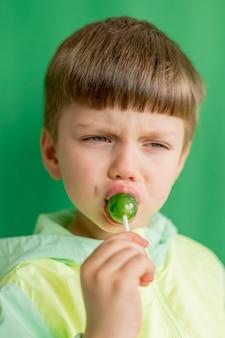Portrait boy eating lollipop