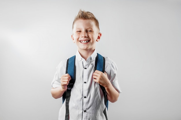Portrait of a boy from an elementary school on a light background
