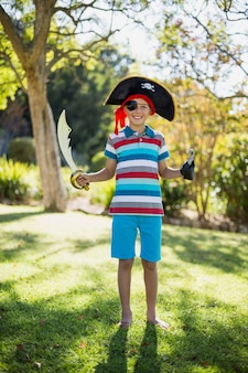 Portrait of boy pretending to be a pirate in the park