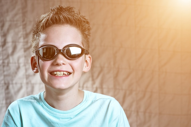 Portrait of a boy in swimming goggles
