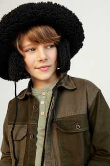 Portrait boy wearing winter hat