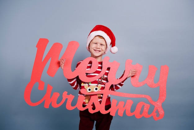 Portrait of boy with christmas lettering