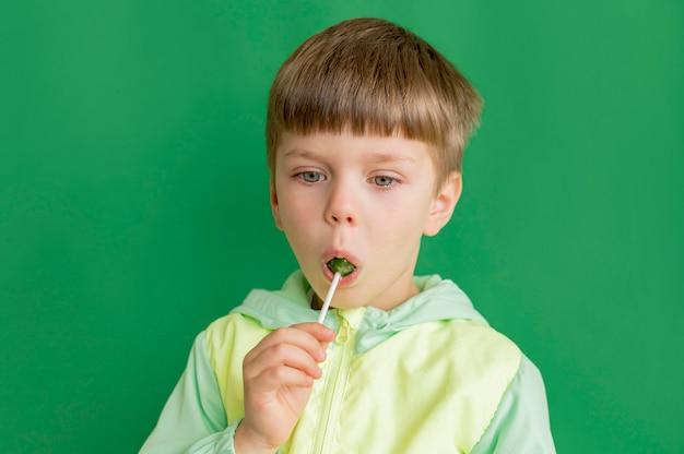 Portrait boy with lollipop