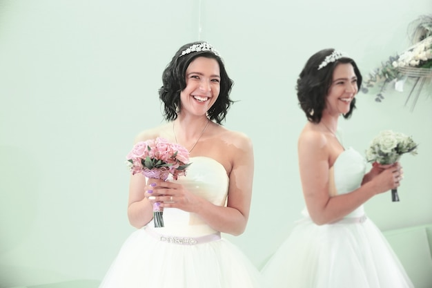 Portrait of a bride standing in front of a mirror. the concept of happiness. photo with copy space