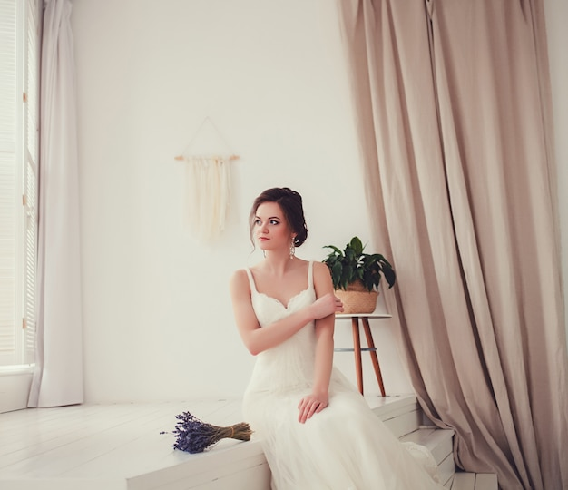 Portrait of the bride in a wedding dress