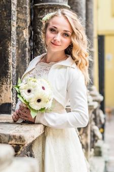 Portrait of bride in white dress