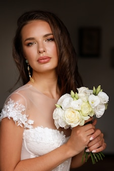 Portrait of the bride with flowers bouquet