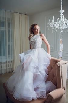 Portrait bride with long locks. in white dress