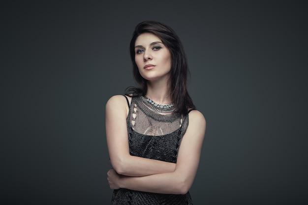 Portrait brunette attractive woman, accent on arms