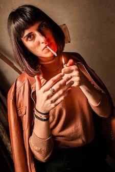 Portrait of a brunette girl lighting a cigarette 11