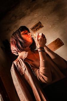 Portrait of a brunette girl lighting a cigarette 15