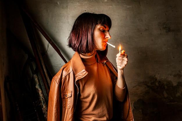 Portrait of a brunette girl lighting a cigarette 5