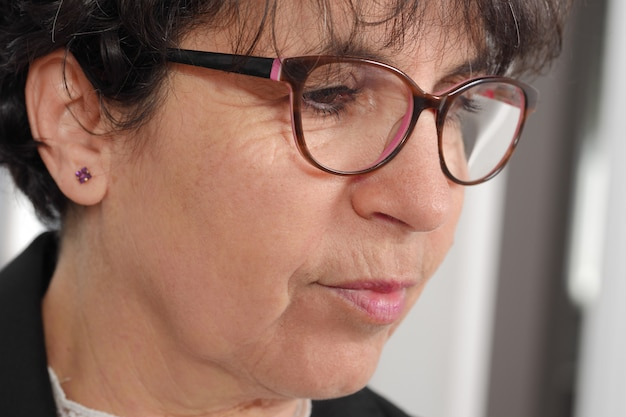 Portrait of brunette mature woman with glasses