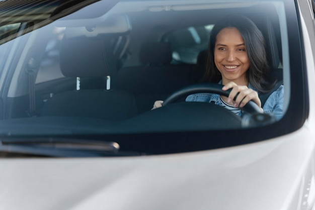 Portrait of brunette woman in her car