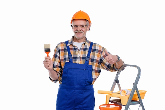 Portrait of a builder in a helmet with tools