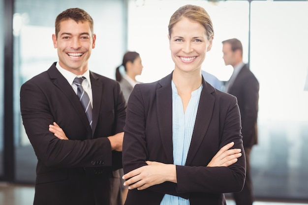 Portrait of business man and business woman smiling