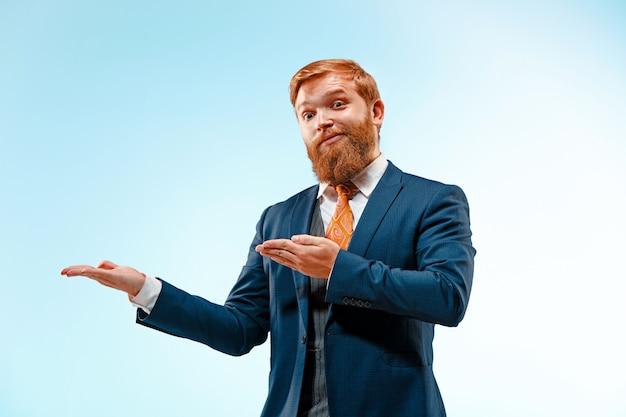 Portrait of a business man showing a copyspace