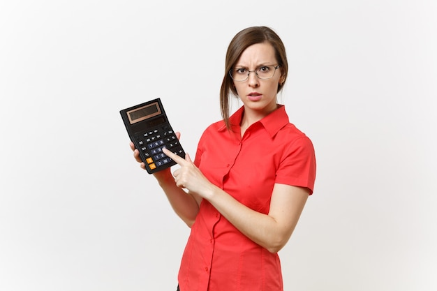 Portrait of business teacher or accountant woman in red shirt, glasses holding calculator in hands isolated on white background. education teaching in high school university, accounting count concept.