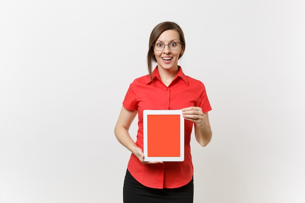 Portrait of business teacher woman in red shirt hold tablet pc computer with blank black empty screen to copy space isolated on white background. education teaching in high school university concept.