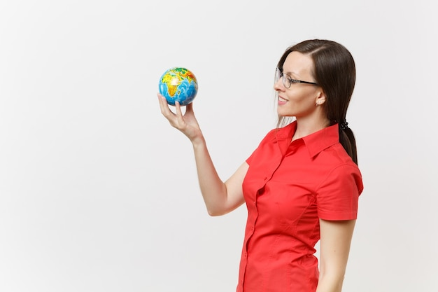 Portrait of business or teacher woman in red shirt holding in palms earth globe isolated on white background. problem of environmental pollution. stop nature garbage, environment protection concept.