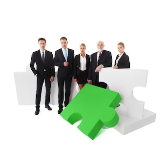 Portrait of business team and puzzle isolated on white background