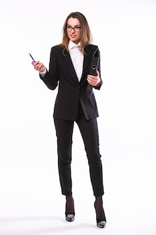 Portrait of business woman holding a folder and pen pointing to something isolated on white