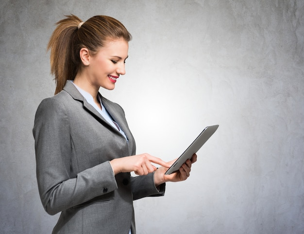 Portrait of a business woman using a digital tablet