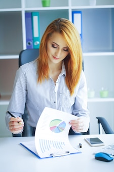 Portrait of business woman with red hair