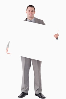 Portrait of a businessman holding a blank panel