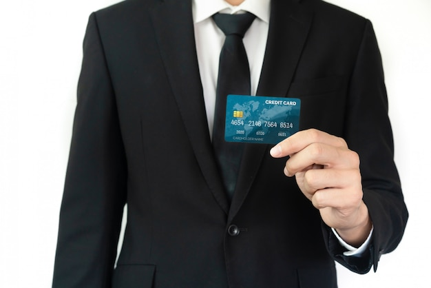 Portrait of a businessman holding a credit card.
