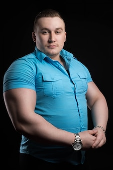 Portrait of businessman weightlifter large muscle